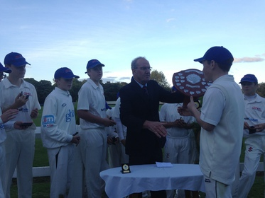 GMCL skipper Dan Ainscough receives the trophy from Andy Kennedy of the LCB