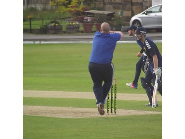 Andrew Sutcliffe bowling.