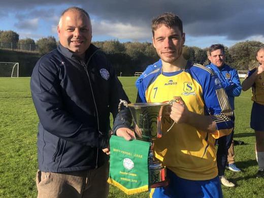Enda Lavelle picks up the Castlecourt Hotel Premier League Cup