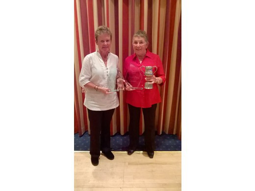 Liz Smerdon & Sue Harriott collecting awards at the recent Bowls Devon lunch