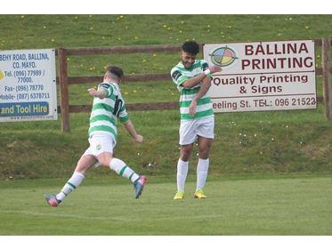 Jordan Loftus celebrates scoring v Ballina Town