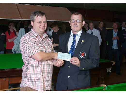 Roy receiving donation cheque from SS Chairman Paul Marinello