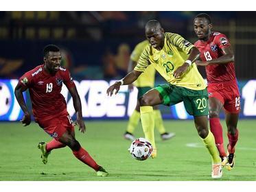 Bafana Bafana midfielder Hlompho Kekana is marked by Namibia's Petrus Shitembi (