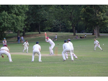 Tom Porter (The Camel) edging Shakil Mahmud (Coach & Horses) towards the slips