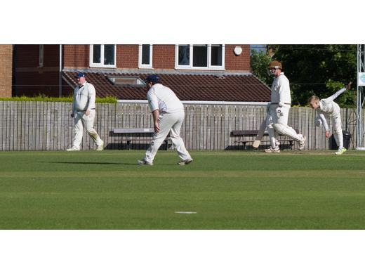 A Hall bowling in his senior debut