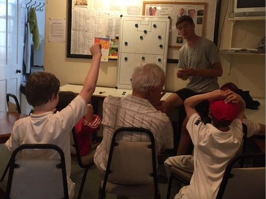 Rain stops training; Tom Murray teaches the Kwik Cricketers fielding positions