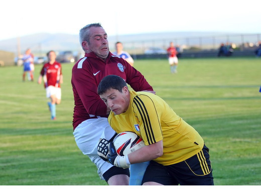 Graham Poke withstands challenge from Marcus Wood