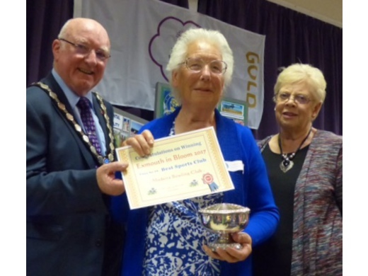 Mavis Mears collects the best Sports Club Garden award
