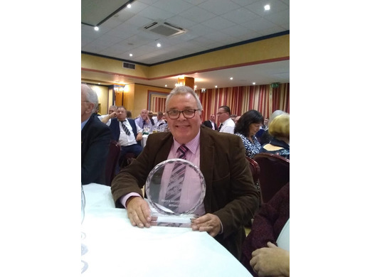 Martin Eveleigh with trophy for Senior Fours