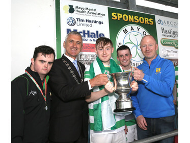 Castlebar Celtic Captain Cillian McNeela is presented with the MCDonnell Cup