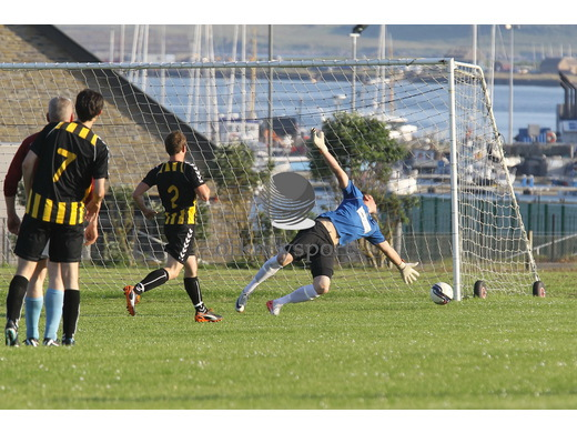 Erik Wilson scores to give Stromness the lead against Rovers