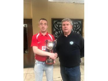 Mayo League Chairman Gerry Sweeney presents the League Two Cup to Eamon Kenny