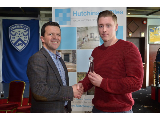 Accepting Player of the Year Award for Lee Nevin, West Bann Ath