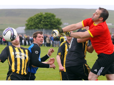 Goalmouth action from Birsay v Sanday Parish game