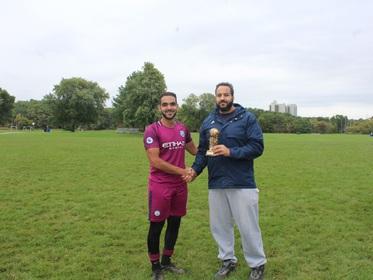 Top Goal Scorer in the League (Bassem Ghoneim) receiving his award
