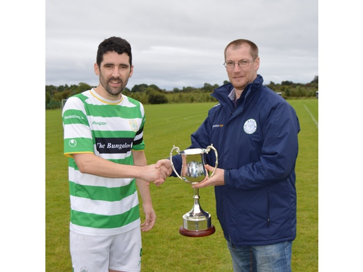 Seamus Hughes presents the League Two Cup to Nicky Canning of Castlebar Celtic B