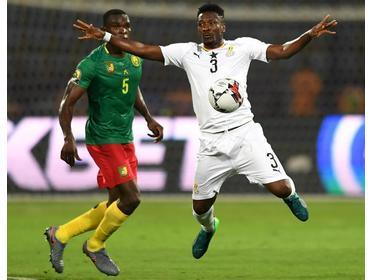 Ghana forward Asamoah Gyan (right) controls the ball during their Afcon Group F