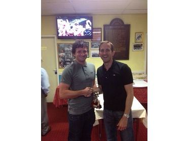Darren receives his trophy from mr Buttle