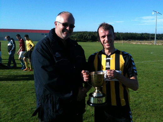Freddie Tait of sponsors HIS Ltd presents Heddle Cup to Rovers Captain, Steven T