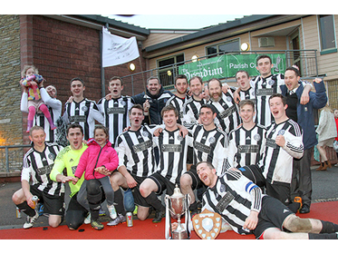Stromness celebrate with the cup.