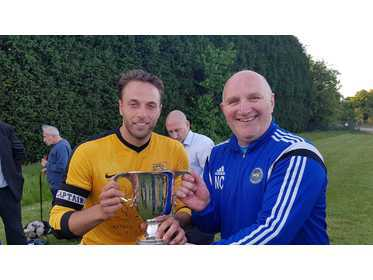 Haroldeans Capt receives Joan Collins Premier Division Trophy from Neil Collins