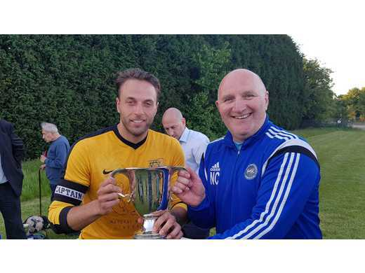 Haroldeans Capt receives Joan Collins Premier Division Trophy from Neil Collins