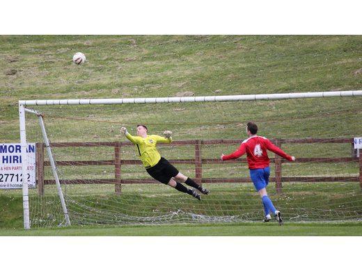 Mark Duffy makes a save v Kiltimagh/Knock United