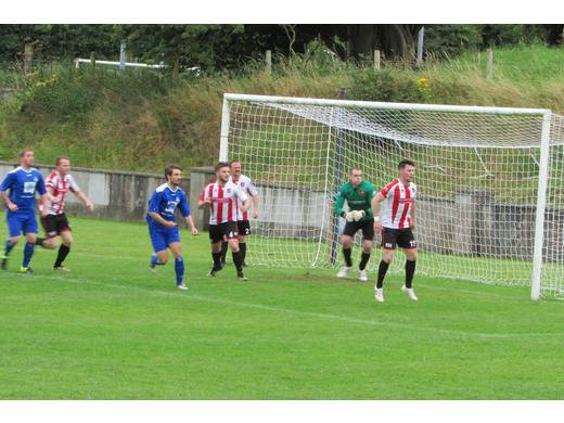 Ballyglass defend a corner from Ballina Town