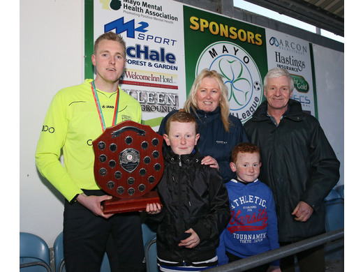 The McEntee Family present the Charity Shield to Gary Cunningham - Westport Utd