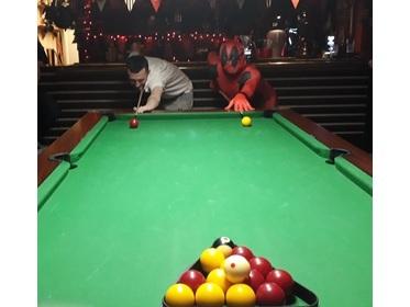 Dead pool swaps swords for pool cue