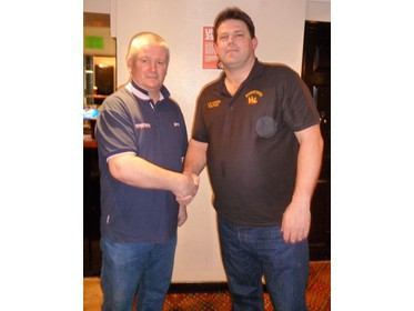 Mike Jarman  of Mowers shakes hands with Reservist counterpart Darren Sparks