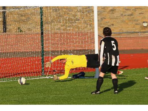 Sinclair Craigie scores the winner past Burray keeper Liam McArthur