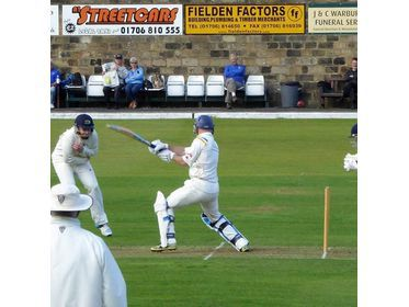 Kristian Garland takes a blow vs Lowerhouse.