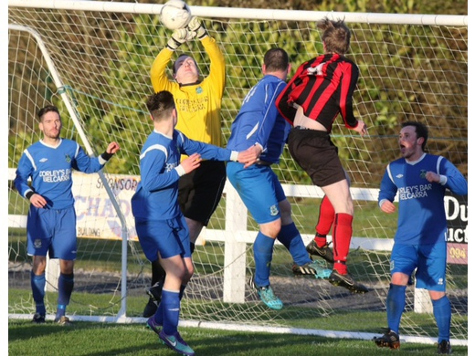 Manulla's Ian Corry punches clear from a corner kick